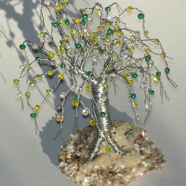 Sal Villano: 'beaded on beach sculpture', 2017 Wire Sculpture, Beach. Artist Description: Beaded on Beach, Wire Tree Sculpture.5 H x 3. 5 W x 3. 5 D Made of  26 gauge galvanized steel wire with yellow, white, clear and green colored glass fringes beads that are wired onto each branch. The tree is mounted on a base of tiny ...