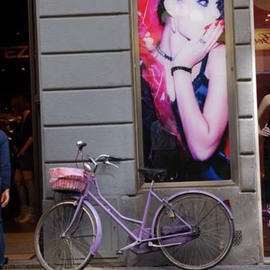 Susan Brannon: 'Advertising on a wall', 2012 Color Photograph, Fashion. Artist Description:    Florence, Italy, advertisement, fashion, poster, woman, surprised,  bicycle, artwork on wall, cityscape, beard, hat, pick bicycle, life, documentary, culture,  photography, susan brannon          ...