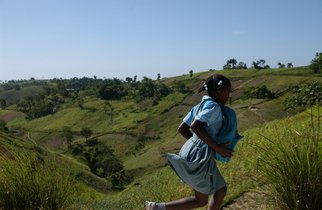 Artist: Susan Brannon - Title: Haiti Girl Running - Medium: Color Photograph - Year: 2012