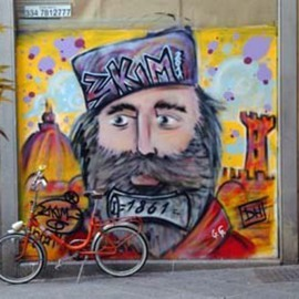 Susan Brannon: 'King on the wall', 2012 Color Photograph, Culture. Artist Description:   Florence, Italy, graffiti, king, bicycle, artwork on wall, cityscape, beard, hat, pick bicycle, life, documentary, culture,  photography, susan brannon         ...
