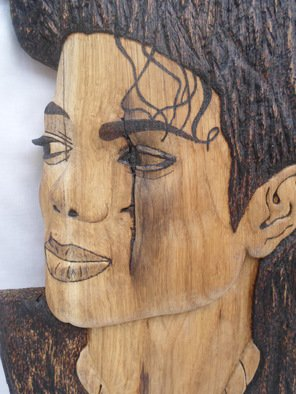 Stefan Irofte: 'Sculpture Wood Michael Jackson', 2014 Wood Sculpture, Celebrity. Artist Description:   A unique and original art work done by hand in wood with distinction. This is a Michael Jackson portret made in oak wood. Initially the wood was in the form of a thick plank and it has been cut in three equal parts and then join together. The ...