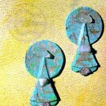 coins dropping ear ornaments By Richard Lazzara