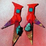 red gradual turquoise ear ornaments By Richard Lazzara