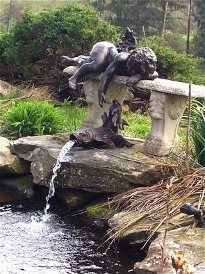 Bronze Sculpture by Morris Docktor titled: Bronze Cherub with Fish, 2012
