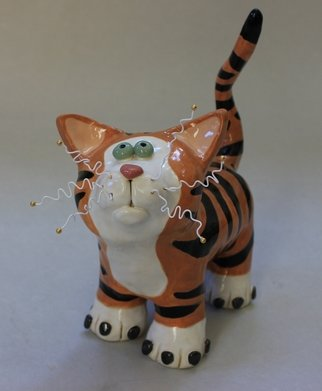 Suzanne Noll: 'Tiger Striped Cat Sculpture Pouncer Item 1181', 2012 Handbuilt Ceramics, Animals.      This beautiful tiger striped, whimsical cat sculpture is made with cat lovers in mind. He was hand created from high fired ceramics and color enhanced with the use of various glazes. I added small embellishments and details to further refine the appeal, such as the button pink nose and the...