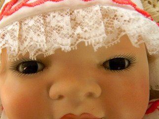 Artist: Debbi Chan - Title:  little doll face - Medium: Color Photograph - Year: 2011