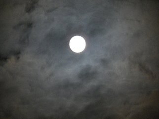 Artist: Debbi Chan - Title: a huuricane or the moon - Medium: Color Photograph - Year: 2012