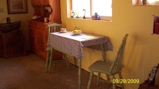 Color Photograph by Debbi Chan titled: eating alone on Easter, created in 2010