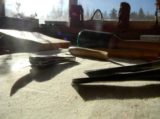 Artist: Debbi Chan - Title: morning light on carving table - Medium: Color Photograph - Year: 2011
