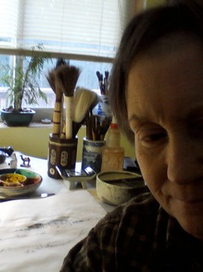 Artist: Debbi Chan - Title: self portrait of artist in studio - Medium: Color Photograph - Year: 2011