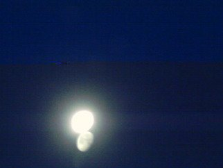 Color Photograph by Debbi Chan titled: two moons in blue, created in 2009