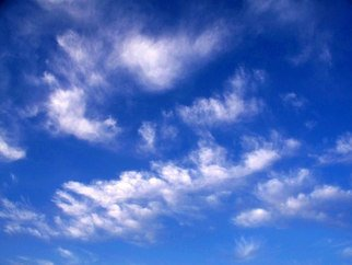 Color Photograph by Debbi Chan titled: white spots in blue sky, created in 2010