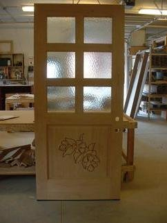 Wood Sculpture by Thom Loveless titled: Columbine Door, created in 2012