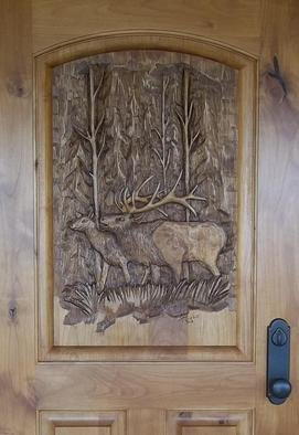 Wood Sculpture by Thom Loveless titled: Elk Door, created in 2012