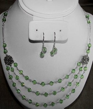 Ana Verde: 'Swarovski Peridot Necklace and Earrings', 2007 Jewelry, Fashion.  A three row necklace made with sterling silver chain and 6mm Austrian Peridot Swarovski Crystals, 2 sterling silver links, 2 sterling silver tubes, 4 sterling silver beads.  Earrings are sterling silver with swarovski crystals.  Necklace  measures  18/ 21