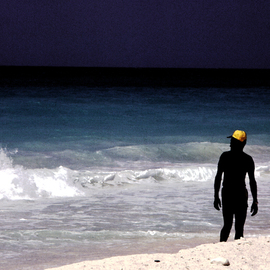 Wayne King: 'The Yellow Cap', 1980 Color Photograph, Figurative. Artist Description:  On a beach in the Carribean a local with a yellow cap creates an interesting contrast to the blue green of the ocean.One original of this image is created, signed, dated and with a certificate of authenticity. The image is used for creation of an open edition ...