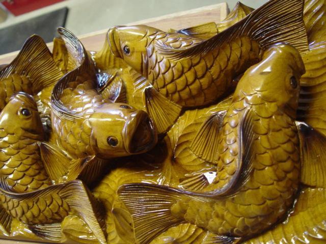 Jim calder 39 koi feeding 39 sculpture wood artwork fish for Koi feeding
