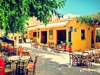 Susan Wellington - Open for dinner: Bright yellow restaurant in Crete, Greece, Food